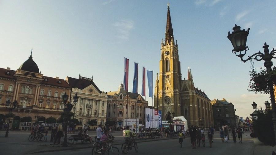 People walking around the pedestrian zone around Freedom Square (Trg Sloboda) in Novi Sad.