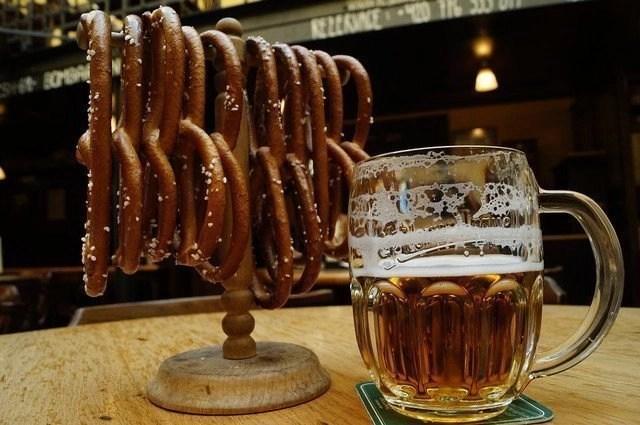 Mug of beer with pretzels.