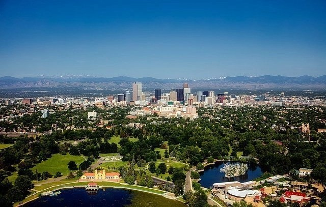 City buildings and mountains in the background of Denver, Colorado.