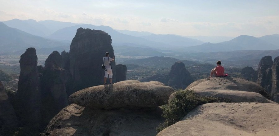 Mand and a women on a rock hill in Meteora