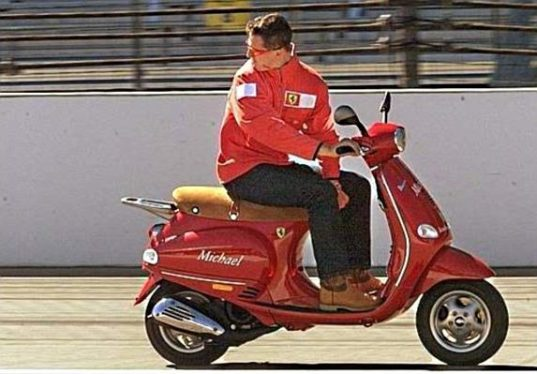 Michael-Schumacher-riding-vespa