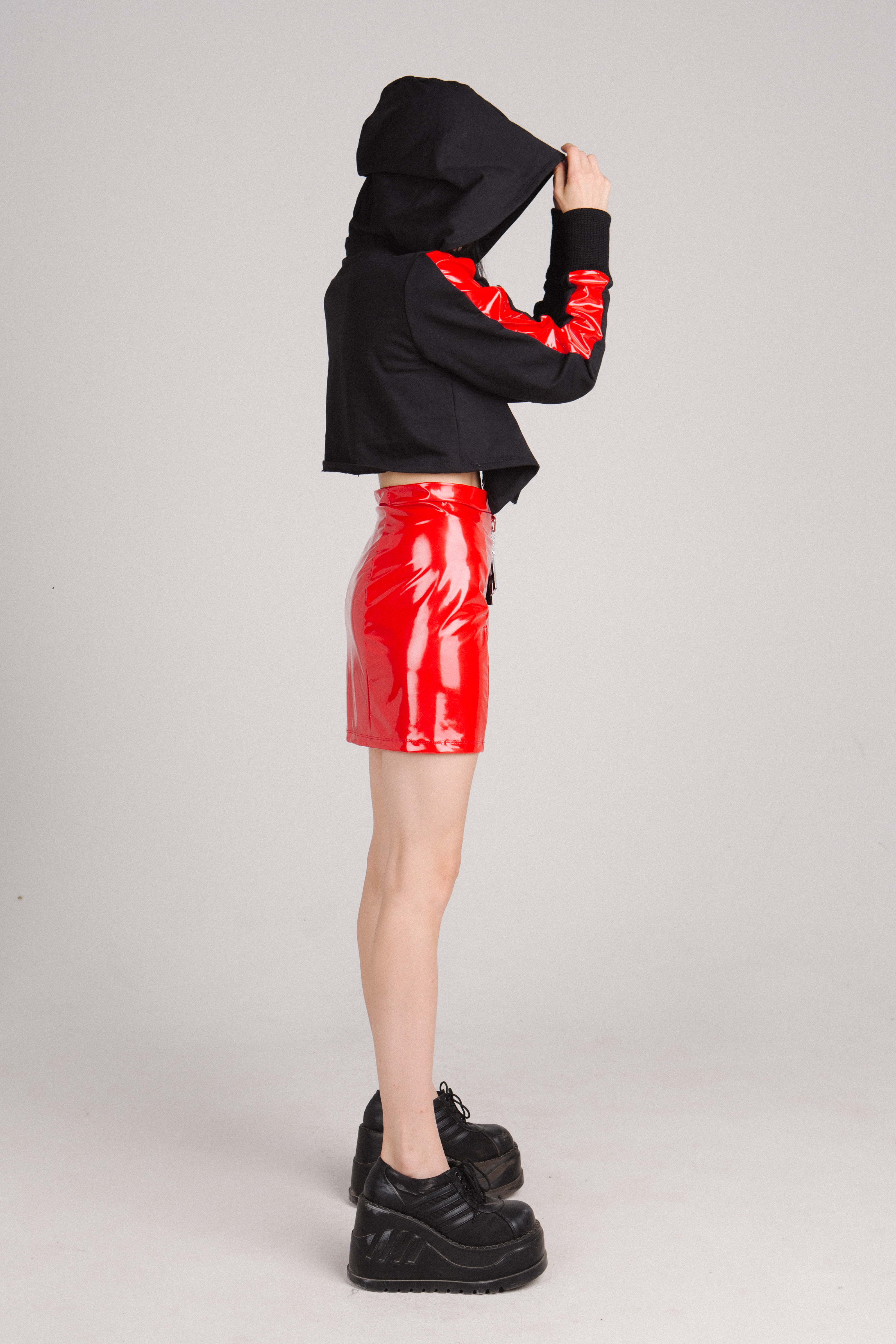 Red shiny skirt and black Racing Day hoodie with buckles