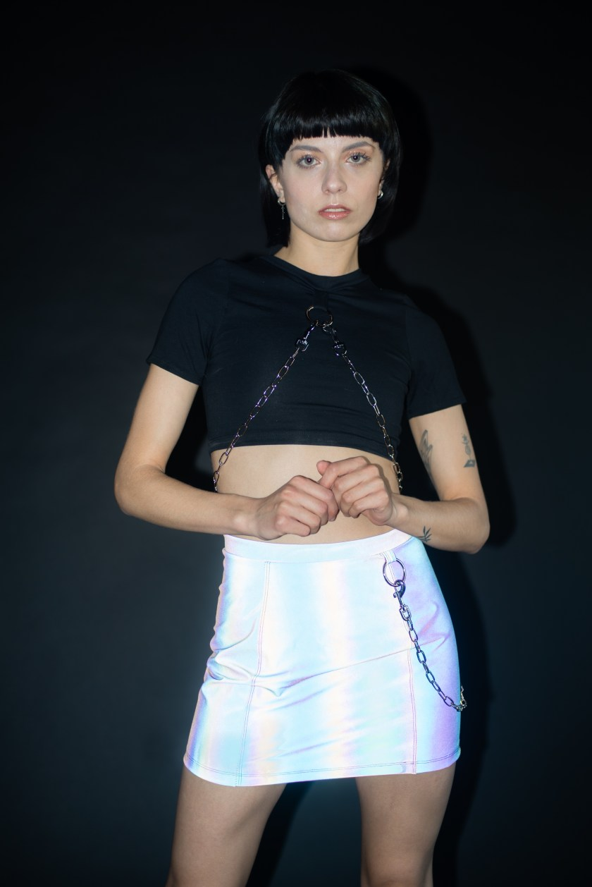 reflective skirt with chain and hardware and black crop top with O ring and chain