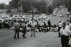 b x w photo of police and protesters