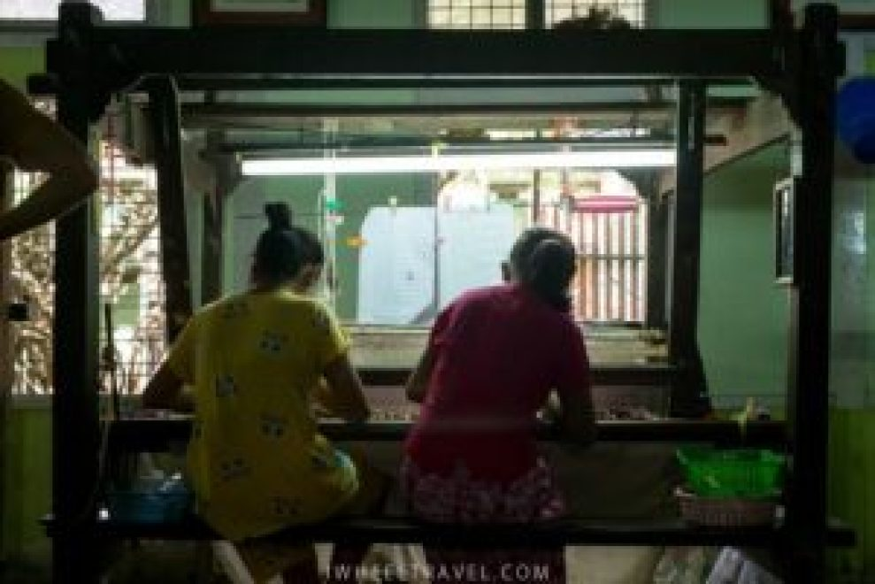 Two women always work together on one weaving loom.