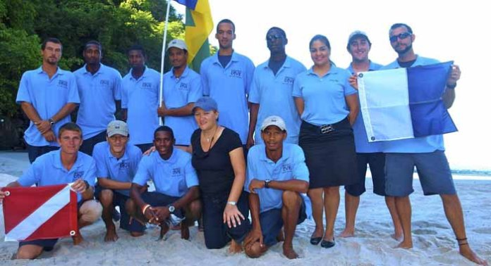 Kay Wilson, in black, and the staff of Indigo Watersports Ltd. (Internet photo)