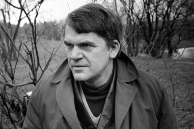"Czech writer Milan Kundera poses in a garden in Prague 14 October 1973. Novelist born in Brno, Czech Republic, Kundera lectured in Cinematographic studied in Prague until he lost his post after the Russian invasion in 1968. His first novel, Zert (1967, The Joke), was a satire on Czechoslovakian-style Stalinism. In 1975 he fled to Paris, where he has lived ever since, taking French nationality in 1981. He came to prominence in the West with his ""The book of Laughter and Forgetting"" in 1979, and ""The Unbearable Lightness of Being"" in 1984 which was filmed in 1987. (Photo credit should read /AFP/Getty Images)"