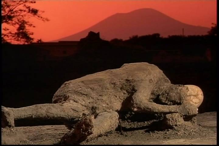 Plaster body cast with Vesuvius in the background.
