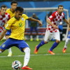 Brazil's Neymar scores from a penalty kick during the 2014 World Cup opening match between Brazil and Croatia at the Corinthians arena in Sao Paulo