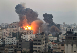 Smoke and fire from an Israeli bomb rises into the air ove Gaza City
