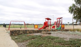 The smaller playground is on the left