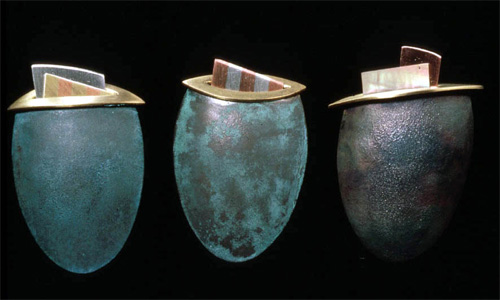 5.19 'Brooches' 1985. white metal (patinated), copper, brass