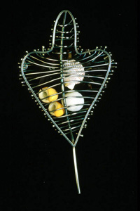 5.50 'A Sense of Place - Sanna Bay' 1997. Brooch; white metal, shell,pebble, seaweed