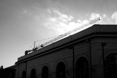 A crane parallel to a building
