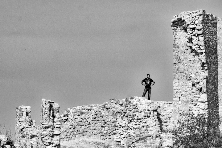 A Dark Clad Figure Upon the Castle Wall