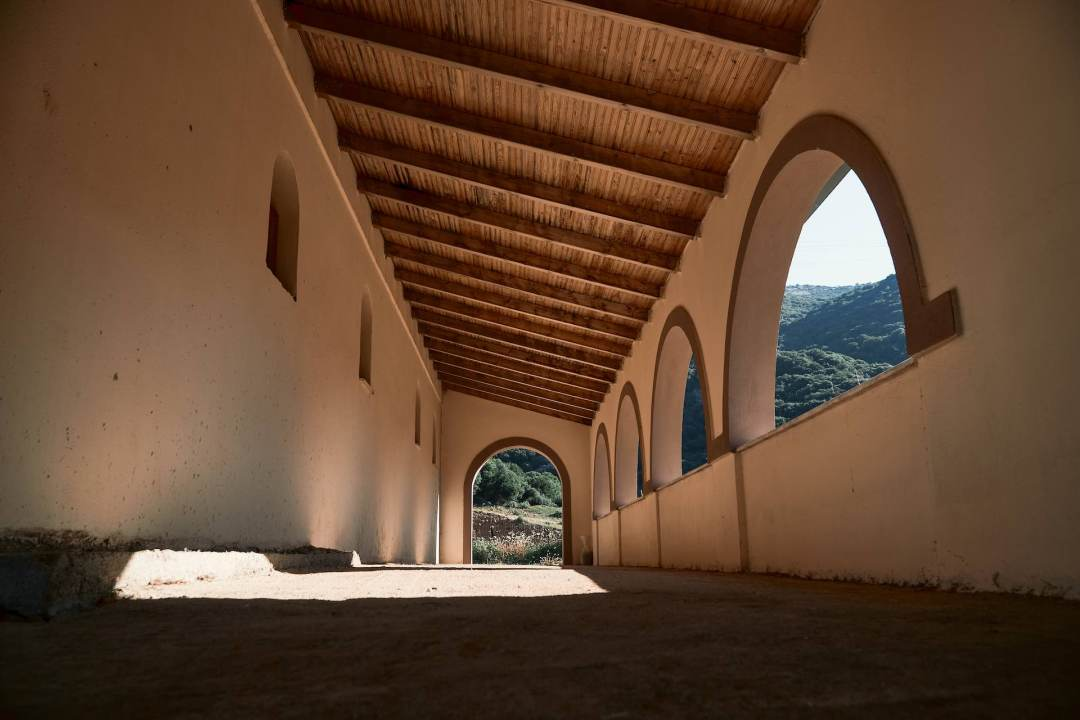 A covered walkway in the side of a church