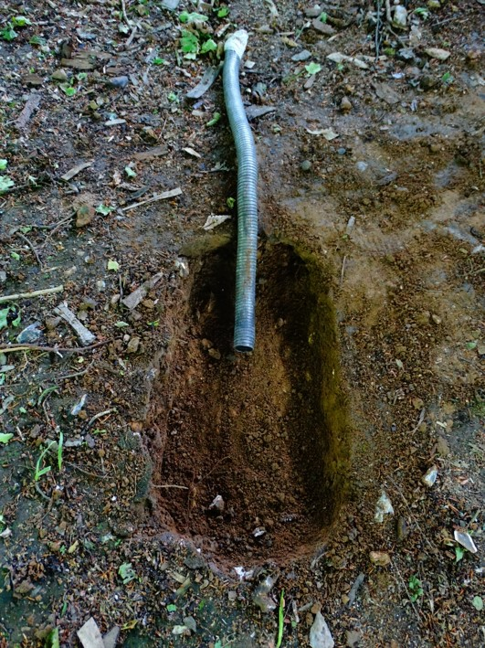 Dig a small hole for the pit forge
