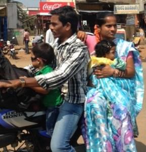 Family riding on motorbike
