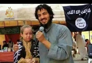 The photo is from twitter (@Fadel_alHadidi) taken as a screenshot from a youtube clip and profess to be an ISIS militant  marrying a 7-year old kafir in occupied minority district of Syria