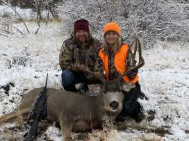 Man and woman with trophy buck at Unit 52