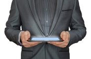 Man on suit holding tablet