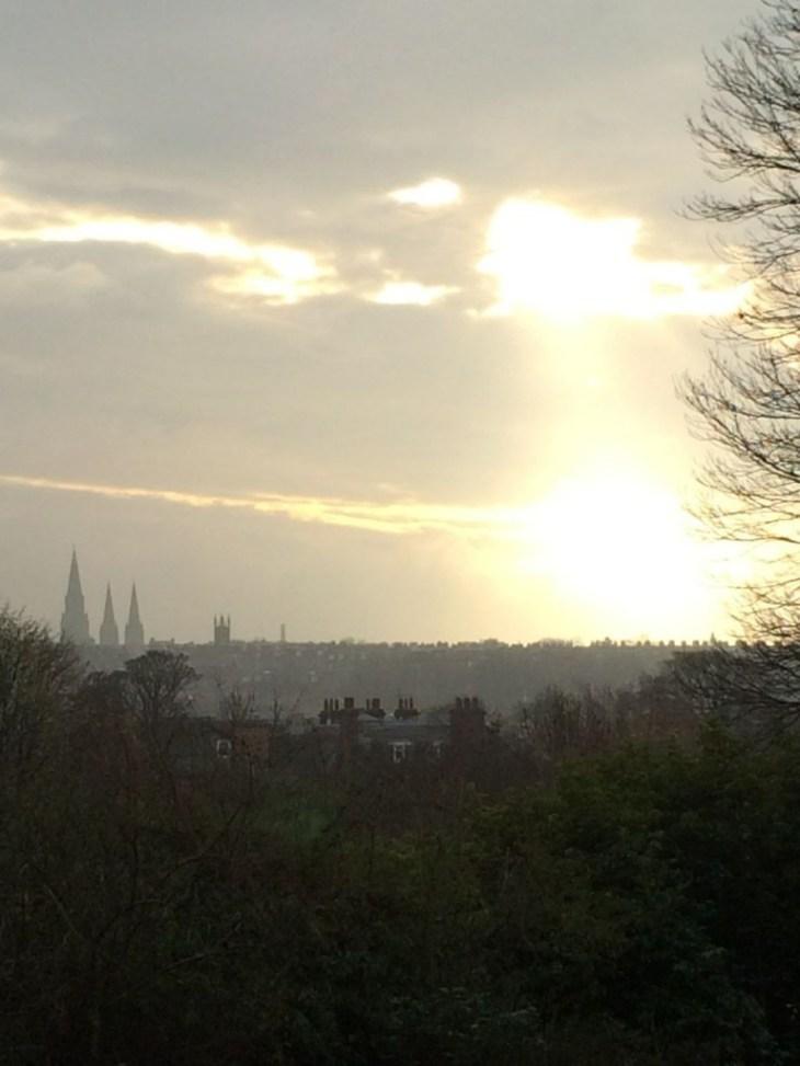 Sun setting on Edinburgh city centre from RGBE