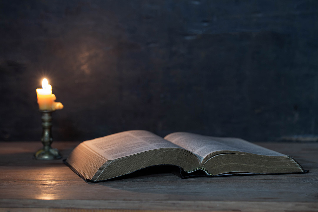 The Bible and a candle