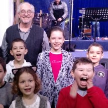 Children learning to sing with Wade Clark