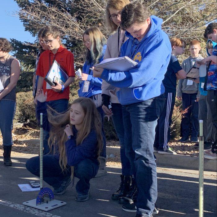 STEM School Highlands Ranch students work on a rocket design at Junior Space Entrepreneur Program