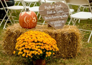 Pick a seat sign at a wedding ceremony