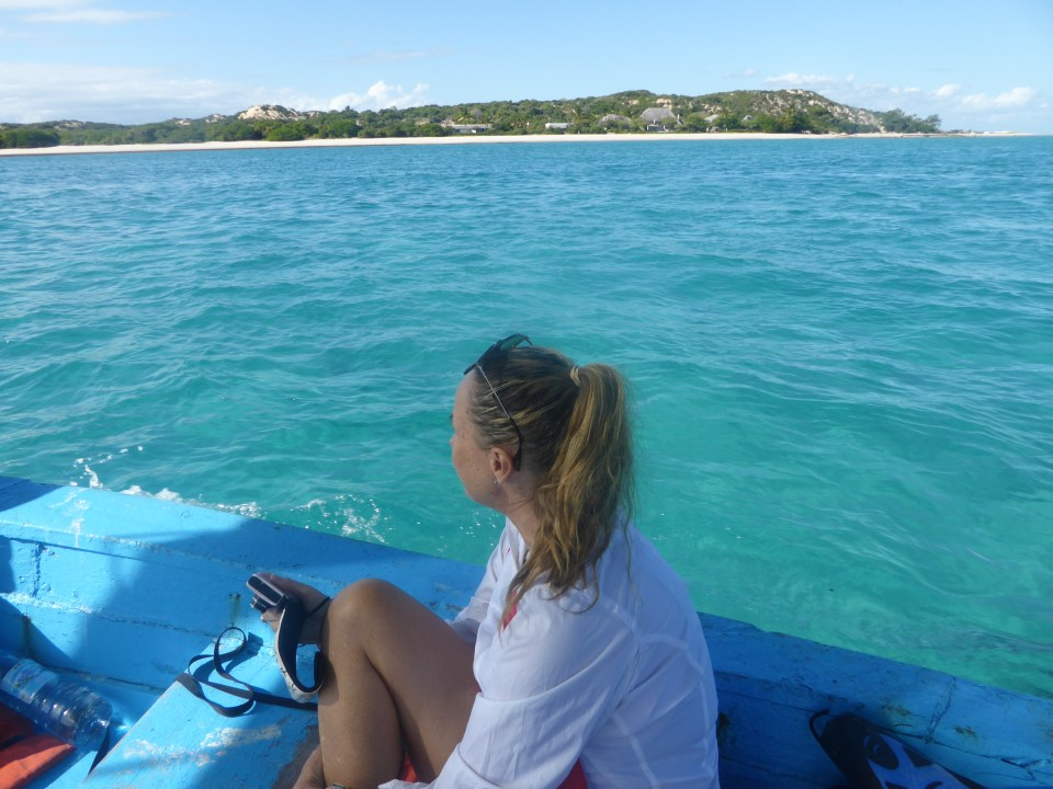 Me sitting on a dhow, Marque island in distance
