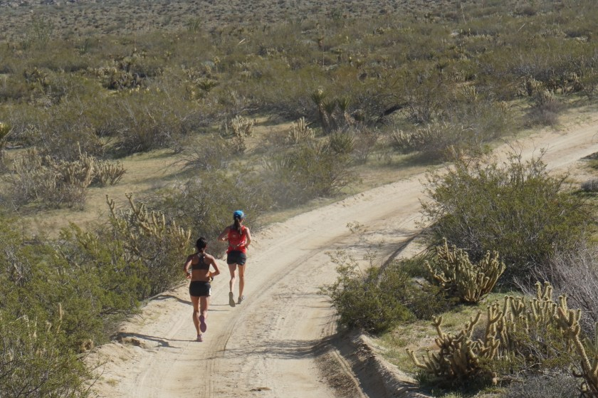 Kathy and I running along the sandy wash leaving mile 16
