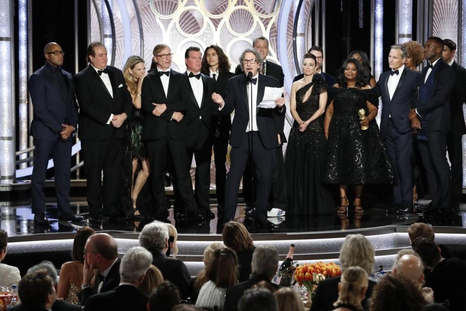 Equipe e elenco de 'Green Book: O guia' agradecem o prêmio de melhor filme de comédia ou musical no Globo de Ouro 2019 — Foto: Paul Drinkwater/NBC Universal/Handout via REUTERS