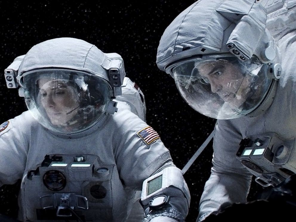 """Sandra Bullock y George Clooney en """"Gravity"""""""