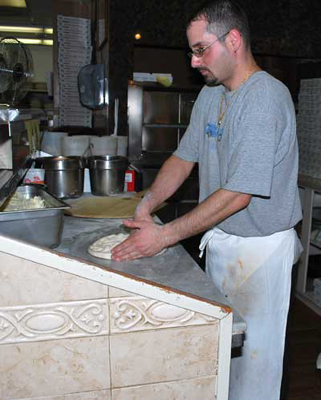 Making pizza at OMA's