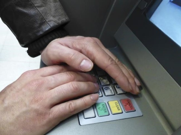 block hand while entering ATM pin
