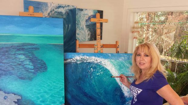 Chelle painting in studio