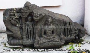 Ruined Tirthankar idol in padmasana - Jain Museum