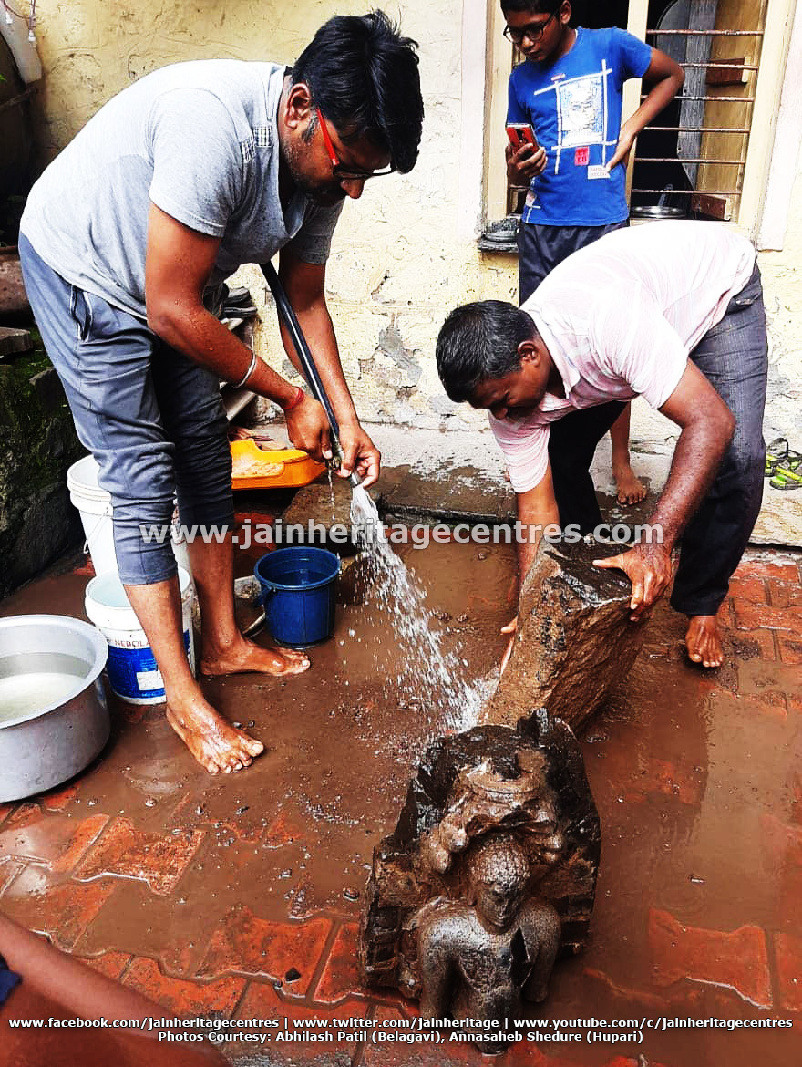 Members of Jain community washing the mutilated Parshwanath Tirthankar Idol.