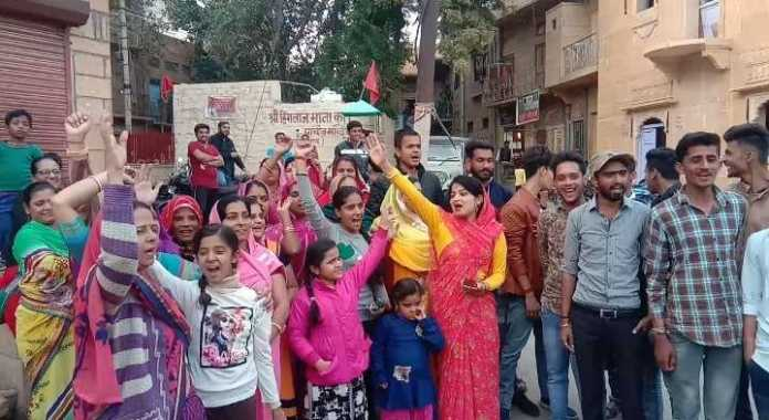 Women's Front expresses happiness by burning firecrackers on the encounter of rapists