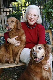 Judy with golden retrievers Agatha and Daphne