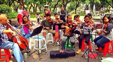 Musisi Jalanan Taman Suropati Jakarta, Jakartatraveller.com.