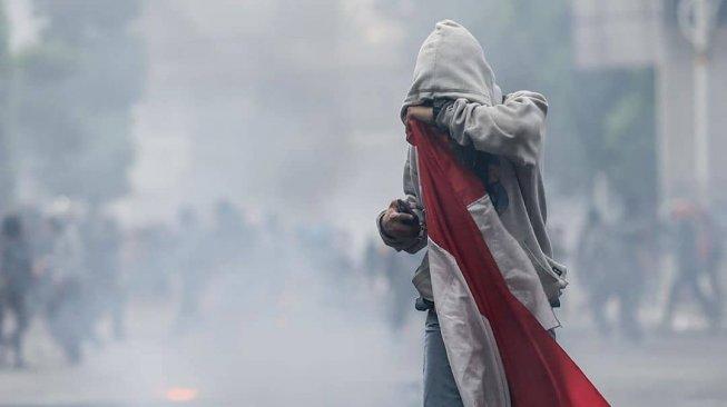 Luthfi alias LA, pembawa bendera merah putih di aksi demo tolak RKUHP dan RUU kontroversial (ist)