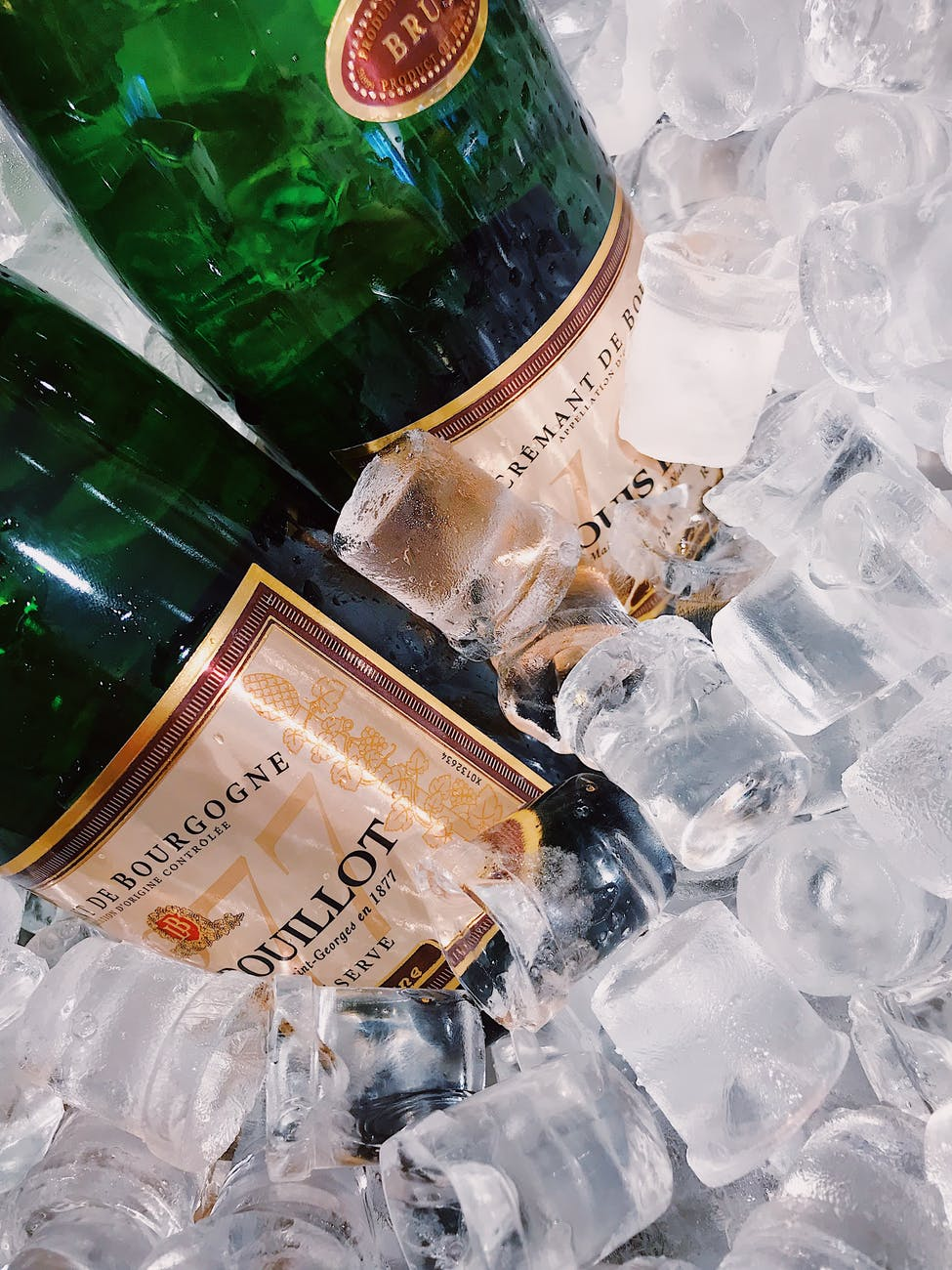 two wine bottles with ice