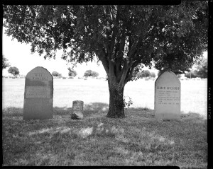 Gravestone markers of Elmer McCurdy and Bill Doolin