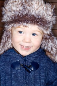 Toddler wearing a furry winter hat