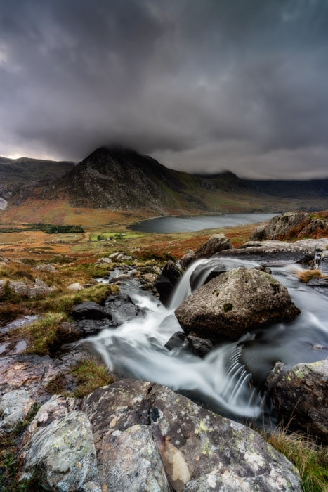 Looking towards Tryfan from Afon Lloer in Snowdonia on a moody autumn evening