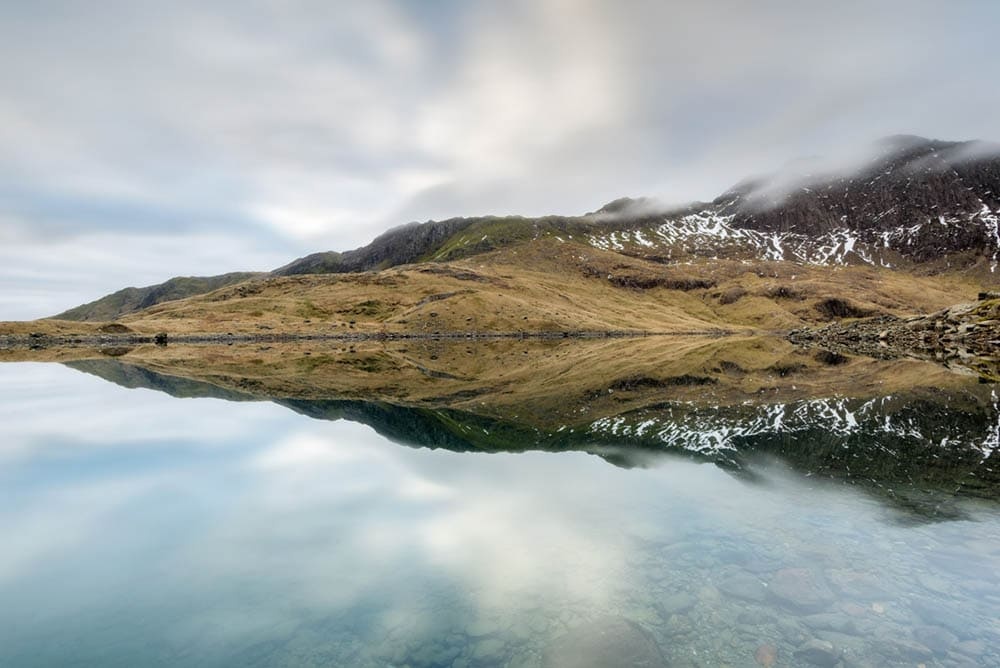 Reflection at Lly Llydaw in Snowdonia, North Wales at sunrise