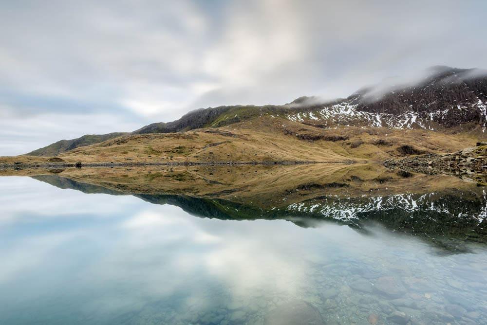 Reflection at Lly Llydaw in Snowdonia, North Wales at sunrise
