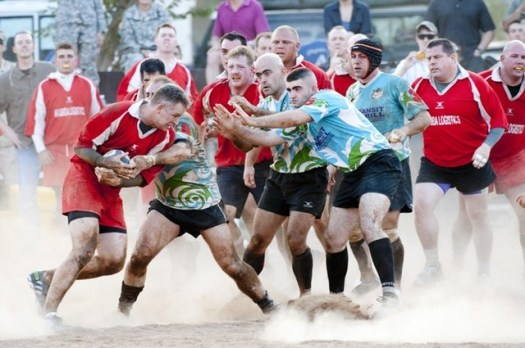 Players playing rugby